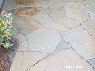 stone patio, spiral detail  by Devine-Escapes