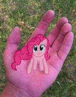 Pinkie In a hand by EROCKERTORRES