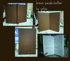 brown pseudo-leather book by yatsu