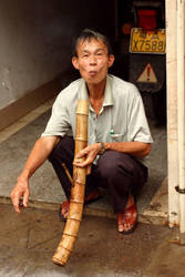 smoking a bamboo pipe by beloutte