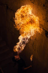 Young man blowing fire from his mouth by Black-Bl00d