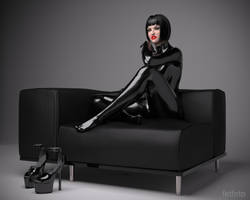 Caitlyn-Black-Rubber-Catsuit-on-Chair by fetfoto