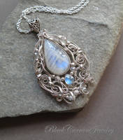 Moonstone Cabochon wrapped in sterling silver by blackcurrantjewelry