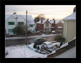 Snowfall in on a suburb road by davidduke