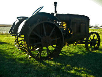 long gone tractor by photographer-jan