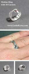 Mobius Strip Ring with Garnets by GeshaR
