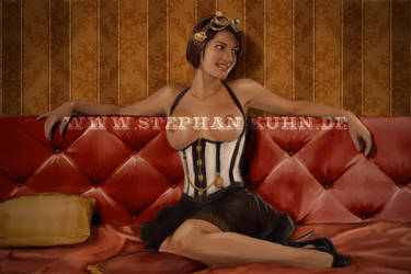 Steampunk Girl on sofa topless by Dinoforce