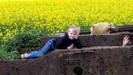 My boy on a tank in a field of yellow flowers by yereverluvinuncleber