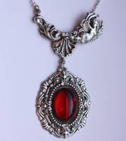 filigree ruby pendant by Pinkabsinthe