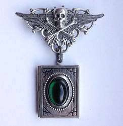 Skull locked book pendant by Pinkabsinthe