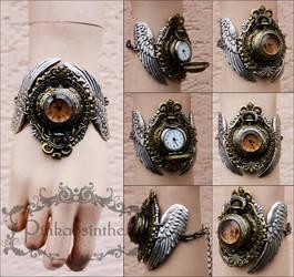 Winged watch cuff I by Pinkabsinthe