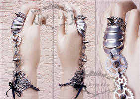 Armored gothic cuff by Pinkabsinthe