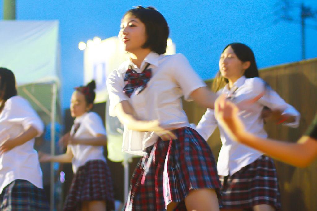 Female student dancing by MinoruneTomo