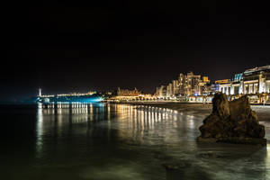 The lighthouse and the city of lights by OlivierAccart