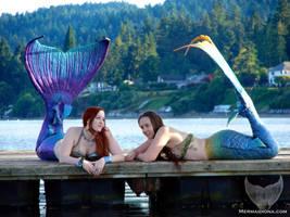 Mermaids on the dock by Mermaid-Iona