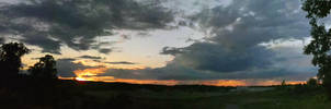 Distant Rains at Sunset by greyorm
