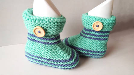 Knitted baby booties by SeptemberM