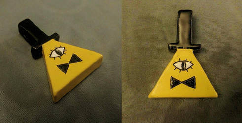 Bill Cipher ceramic pendant by icedragonsheart