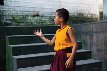 Young monk playing by khurafati