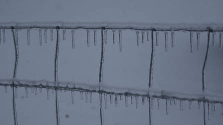 icicles on wire fence by madetobeunique