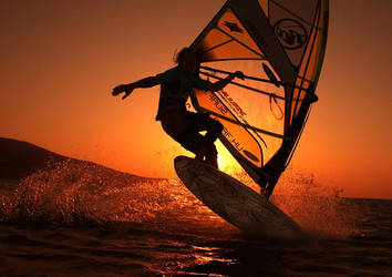 Sunrise windsurfing by blindrider