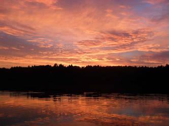 Sunset on a lake by baronjungern