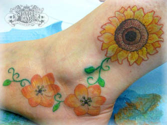 Sunflower on foot by state-of-art-tattoo