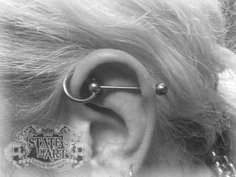 Slave bar piercing by state-of-art-tattoo