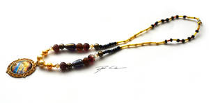 The abstract gold necklace (on sale) by PixieCold