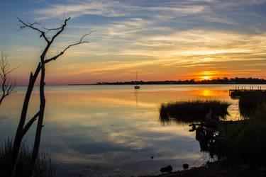 Sunset over Albemarle Sound by captainslack