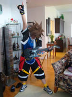 Sora plays Guitar Hero by blueheart29