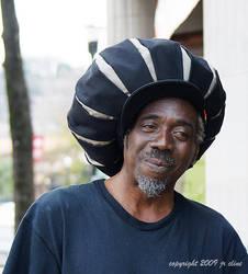 Man in a big hat by eskimoblueboy