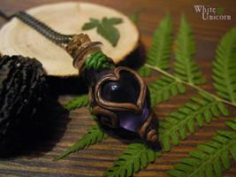 Purple 'potion' pendant by Ilvirin