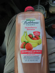 drinking fruit smoothie.  by jjdepatie