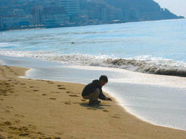 boy playing in the sand, Korea by sataikasia