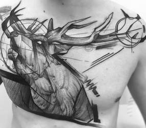 Tattoo on chest by TattooSoulcom