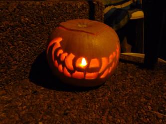 Creepy Grin Jack-o-lantern 2011 lit by TNHawke