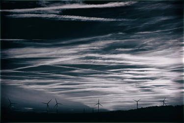 Silhouettes of wind turbines by PhotoartBK
