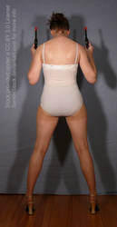 Back Pose Reference Dual Revolvers for Art Drawing by SenshiStock
