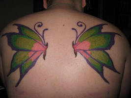 Touched up tattoo by MistressInsanity
