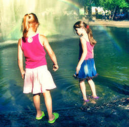 girls playing in the fountain by EmaGover