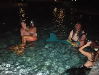 Holding Mermaids by onelilmermaid