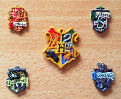Hogwarts crests by EerieStir
