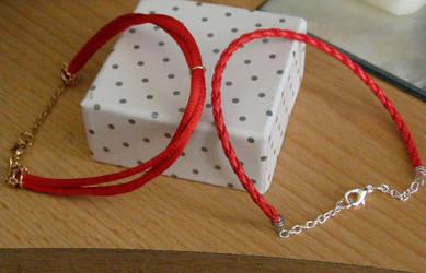 Red bracelets by chupacabra-itt