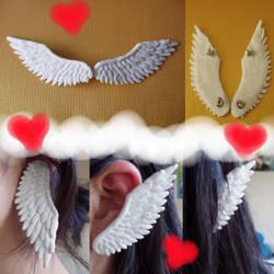 White Winged Ears by KittyAzura