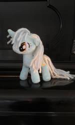 Lyra on a piano by DraglaPlushies