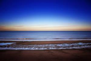 North Sea Dusk with Walker+Dog: Norfolk UK by Coigach