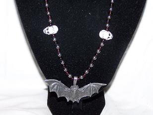 Skull+ Bat necklace close up by graveinimages
