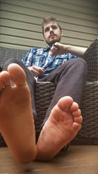 Cute guy with nice feet  by Gaggedgamer