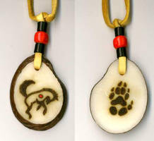'Wolf Dance' tagua pendant by Foxfeather248